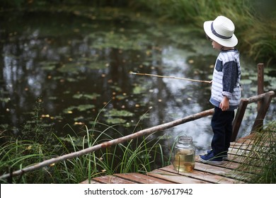 Young scouts. Children on a camping trip. Fish for fishing on a pond and river. Grandmother's vacation in the village.