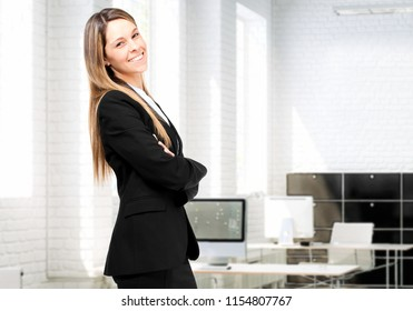 Young secretary smiling in her office