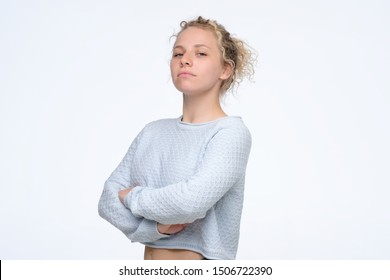 Young self confident woman with proud and arrogant emotions on face. Curly blonde girl self proud and does not care about other people
