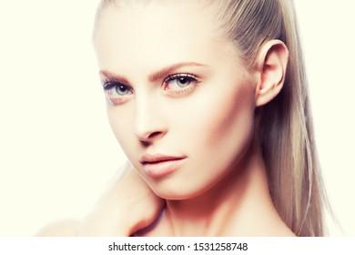 Young sensual beauty woman face, perfect skin, happy girl, natural make-up
