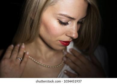 Young sensual BLONDE model girl pose in studio.