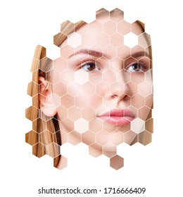 Young sensual blonde woman with mosaic honeycombs on face. Over white background.