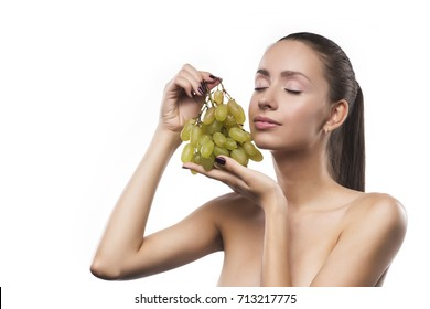 young sensual girl beauty portrait with a green grapes isolated on a white background. copy space.