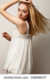 Young sensual girl in fashion clothes pose in studio.