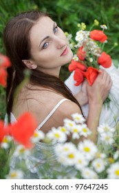 young sensual girl in poppies field