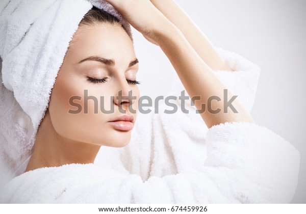 Young sensual woman with bath towel on head.