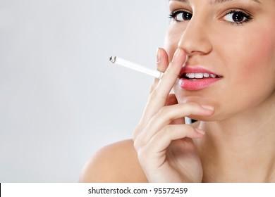 Young sensual woman smoking