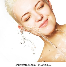 Young sensuality beautiful woman with clean skin with splash of water - white  background