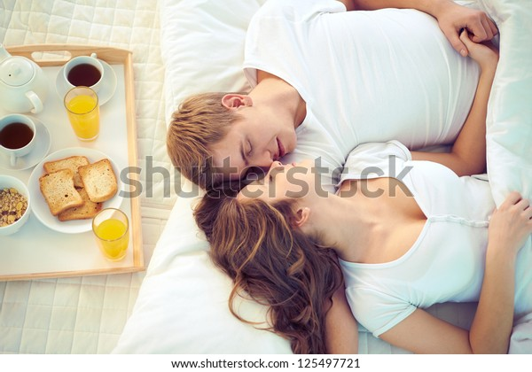 Young serene couple sleeping together