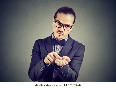 Young serious business man in glasses asking for more money to pay back debt