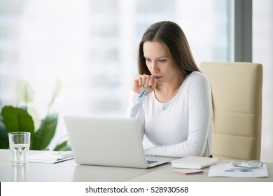 Young serious businesswoman working at the modern office desk with laptop, nervous breakdown, waiting for interview, exam, medical test result, financial issues anxiety, single woman depression