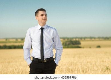 Young serious man on the field