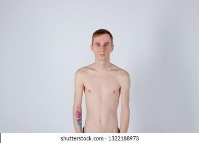 Young serious man posing and looking at camera