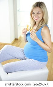 young sexily pregnant woman with two Easter bunnies from dough