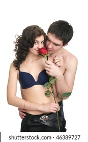 Young sexual couple with red rose isolated over white background