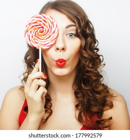 Young sexual woman holding lollipop. Lifestyle.