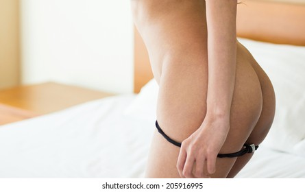 Young sexy asian woman ass in room, Thong off.