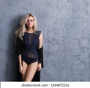 Young, sexy and beautiful blond woman posing in lingerie.