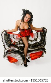 Young sexy brunette dancing in studio a french cancan