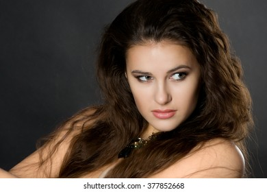 young sexy brunette. seductive pretty woman with curly hair