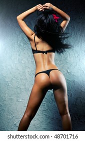 Young sexy brunette woman dancer.