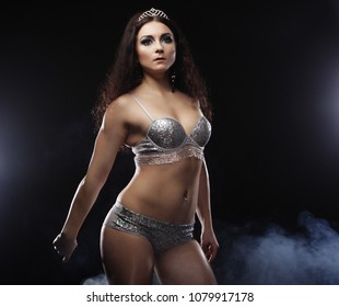 young sexy brunette woman in lingerie over dark background