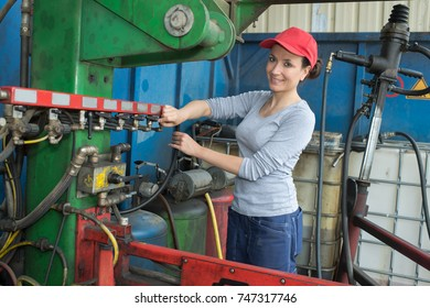 young sexy brunette woman working as industrial mechanic