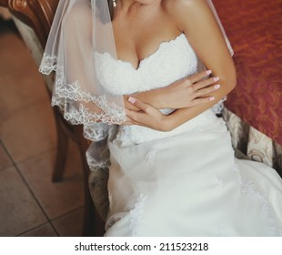 Young sexy caucasian bride on wedding day.