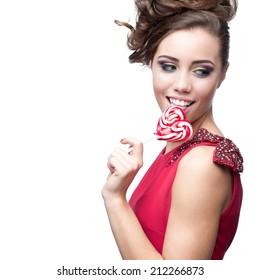 young sexy caucasian brunette woman holding lollipop