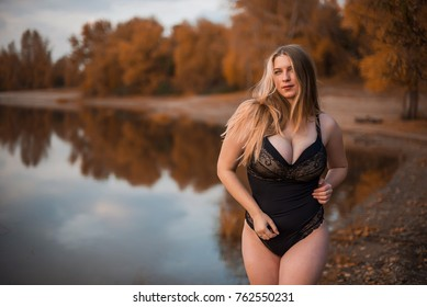 Young Sexy Chubby Girl In Black Lace Body With Very Large Breasts Lying In