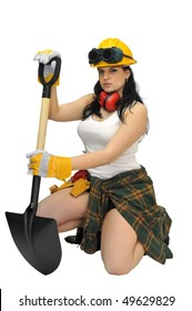 Young sexy construction worker girl with a shovel isolated in white