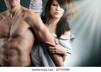 Young sexy couple touching each other
