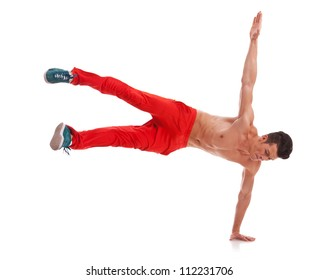 Young sexy dancer standing on one hand. Holding legs in air. Isolated on white in studio. Front view, whole body