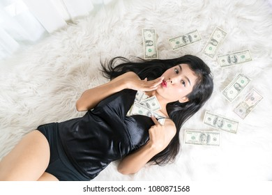 Young sexy female and dollar bills