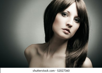 The young sexy girl in chestnut-coloured wig