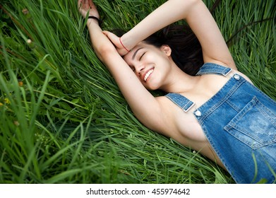 young sexy girl smiling on the green grass background