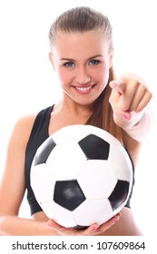 Young and sexy girl with soccer ball over white background