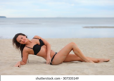 young sexy girl in a swimsuit at the sea