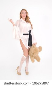 Young sexy girl with teddy bear is scared