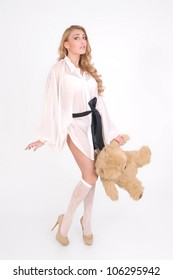 Young sexy girl with teddy bear is shy