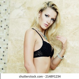 Young sexy lingerie woman posing near a bath