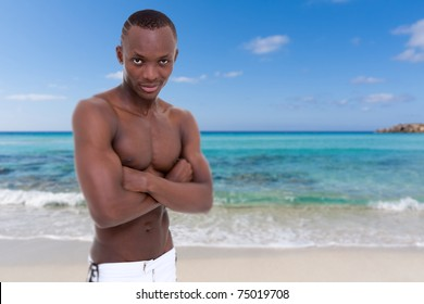 young sexy man posing on the beach