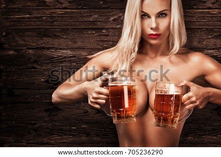 Young Sexy And Naked Oktoberfest Woman Serving Big Beer Mugs On Wood Background