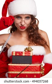 young sexy new year woman or girl with long brunette hair and pretty face in red christmas santa claus holiday dress