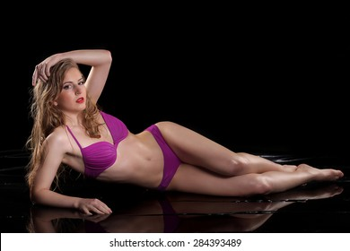 Young sexy nude woman posed wet. Water studio photo. fresh