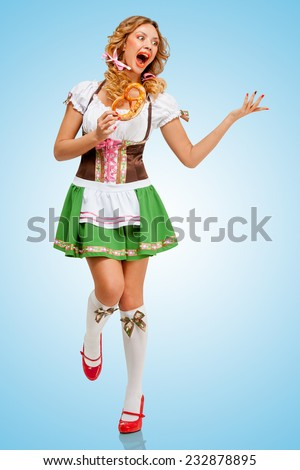 5d4fdcd21abe Young sexy Oktoberfest woman wearing a traditional Bavarian dress dirndl  dancing with a pretzel in hands