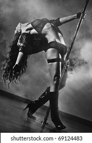 Young sexy pole dance woman. Black and white colors.