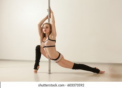 Young sexy poledance girl stretching in lingerie