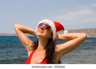 young sexy santa girl in the sea