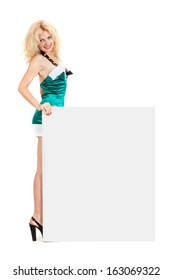 Young sexy Santa woman is holding a poster isolated a on white background
